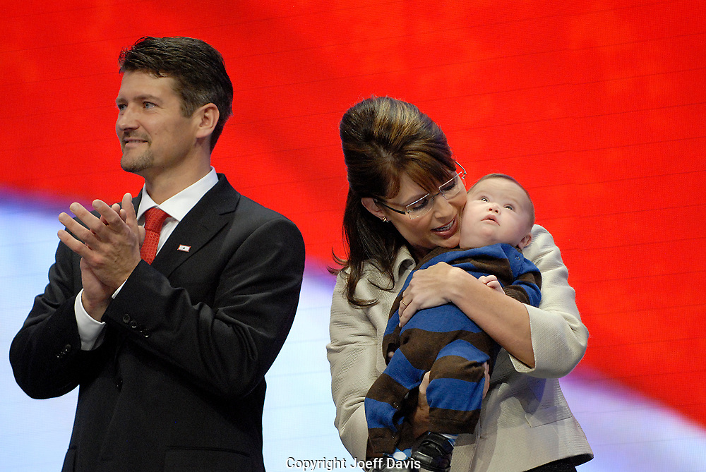 Alaska Governor and Republican Vice President nominee Sarah Palin with her husband Todd Palin and son Trig Palin at the 2008 Republican National Convention at the Excel Center in St. Paul, Minnesota.
