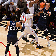22 December 2018: San Diego State Aztecs guard Jeremy Hemsley (42) and forward Matt Mitchell (11) double team Brigham Young Cougars guard TJ Haws (30) in the first half as he dishes off a pass. The Aztecs beat the Cougars 90-81 Satruday afternoon at Viejas Arena.