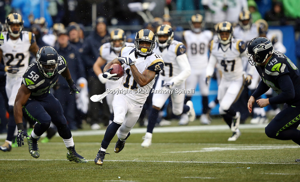 St. Louis Rams wide receiver Tavon Austin (11) is chased by Seattle Seahawks outside linebacker Kevin Pierre-Louis (58) and Seattle Seahawks long snapper Clint Gresham (49) as he returns a second quarter punt inside the Seahawks 30 yard line during the 2015 NFL week 16 regular season football game against the Seattle Seahawks on Sunday, Dec. 27, 2015 in Seattle. The Rams won the game 23-17. (©Paul Anthony Spinelli)