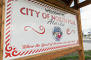 Sign welcoming visitors to North Pole, Alaska. The tiny town is home to the Santa Claus House and Shop, a popular tourist destination.