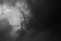 A plane flies through a storm over Indianapolis