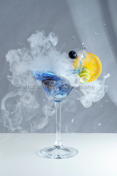 Splashing, smoky craft cocktail with fruit