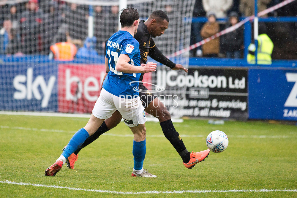 Macclesfield Town midfielder Theo Archibald challenge the opponent  during the EFL Sky Bet League 2 match between Macclesfield Town and Mansfield Town at Moss Rose, Macclesfield, United Kingdom on 16 November 2019.