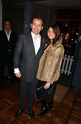 Club owner PIERS ADAM and MISS SOPHIE VANACORE at a party to celebrate the publication of 'E is for Eating' by Tom Parker Bowles held at Kensington Place, 201 Kensington Church Street, London W8 on 3rd November 2004.<br />