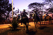 Cowboys meet after arriving from different parts of the country riding to Barretos to take part in Latin America's biggest Rodeo festival, Brazil, Wednesday, Aug. 22, 2012. (Bloomberg Photo/ Dado Galdieri) Brazil is on a quick path to become a global power. Rising economy, big infrastructure projects, an emerging and eager consuming middle class and the booming national industry are the evidences and consequences of the wealth in the southern nation. But the often hidden source of all this wealth falls far from the luring Rio beaches or the Kolkata-New York mix that Sao Paulo is. Behind texan hats and a similar attitude the countrymen display their power through a myriad of projects, festivals and behavior visually analyzed here.