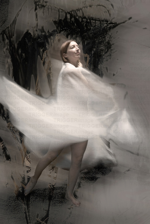 A young woman moving with a white veil