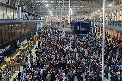 Waterloo Station, London, June 23rd 2016. Commuters face severe delays at London's Waterloo Station as bad weather causes power failures across the rail network. PICTURED: The concourse of Waterloo station jammed with commuters.