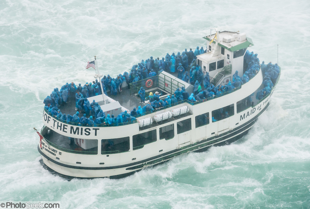 The Maid of the Mist cruises up to Horseshoe Falls (or Canadian Falls) on the Niagara River, starting from Niagara Falls, New York, USA. The town of Niagara Falls in Ontario, Canada, gives excellent views of all three sections of Niagara Falls, which drops 167 feet (51 m). Niagara Falls has the highest flow rate of any waterfall in the world. Niagara Falls is the name for the combined flow of Horseshoe Falls, American Falls and Bridal Veil Falls, on the Niagara River along the international border between Ontario, Canada and New York, USA. The Niagara River drains Lake Erie into Lake Ontario. Horseshoe Falls is the most powerful waterfall in North America, as measured by vertical height combined with flow rate. The falls are 17 miles north-northwest of Buffalo, New York and 75 miles south-southeast of Toronto.