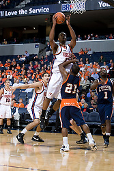 Virginia Cavaliers F Jamil Tucker (12) shoots over Carson-Newman Eagles G Darren Williams (21).  The Virginia Cavaliers men's basketball team defeated the Carson-Newman Eagles 124-65 in an exhibition basketball game at the John Paul Jones Arena in Charlottesville, VA on November 4, 2007.