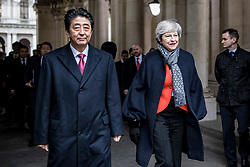 © Licensed to London News Pictures. 10/01/2019. London, UK. Prime Minister Theresa May (R) and Prime Minister of Japan Shinzo Abe (L) walk past the media as they arrive in Downing Street for a bilateral meeting. Photo credit: Rob Pinney/LNP