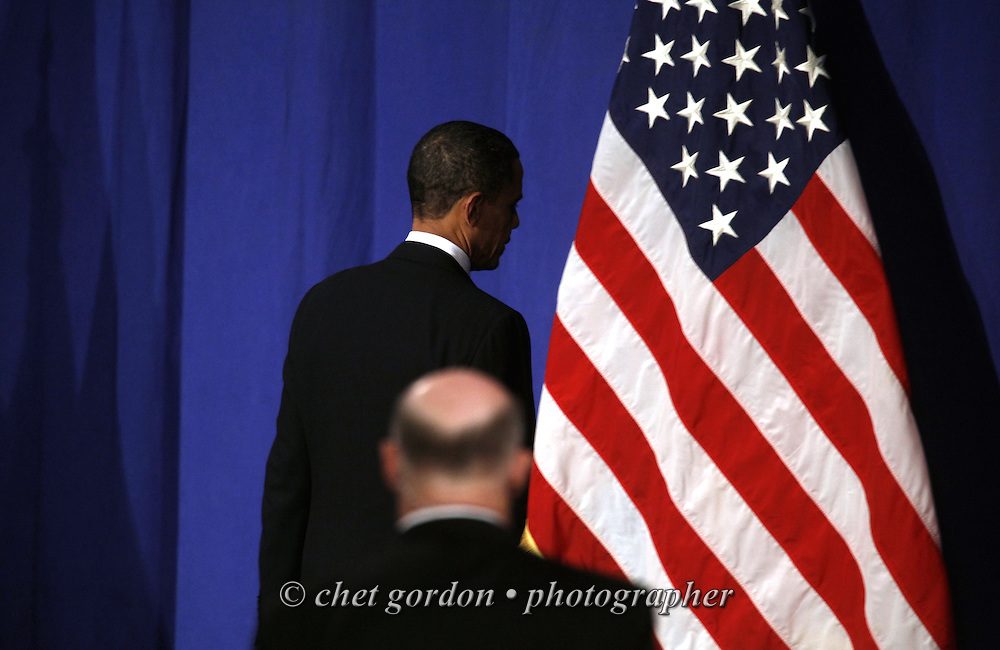 President Barack Obama is followed by a Secret Service agent as he leaves Eisenhower Hall after delivering his national address at the United States Military Academy in West Point, NY on Tuesday, December 1, 2009. President Obama called for an additional 30,000 troops be sent to Afghanistan.