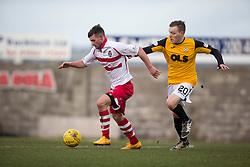 Stirling Albion's Phil Johnston and East Fife&rsquo;s Jamie Insall. <br /> Half time : East Fife 0 v 0 Stirling Albion, Scottish Football League Division Two game played atBayview Stadium, 20/2/2106.
