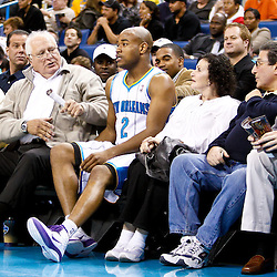 December 17, 2010; New Orleans, LA, USA; New Orleans Hornets point guard Jarrett Jack (2) stumbles into an empty seat courtside following a collision with Utah Jazz point guard Ronnie Price (not pictured) during the second half at the New Orleans Arena.  The Hornets defeated the Jazz 100-71. Mandatory Credit: Derick E. Hingle