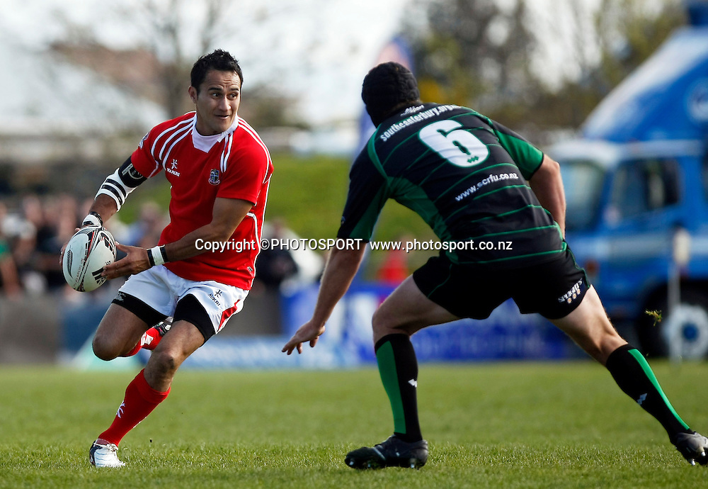 Poverty Bay player Kahu Tamatea with the ball and Eric Smith in defence during the Heartland Championship Lochore Cup Final between, South Canterbury v Poverty Bay at Alpine Energy Stadium, Timaru, South Canterbury. Saturday 8 October 2011. Photo : Joseph Johnson/photosport.co.nz