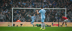 MANCHESTER, ENGLAND - Sunday, January 8, 2012: Manchester City's Sergio Aguero celebrates scoring the second goal against Manchester United during the FA Cup 3rd Round match at the City of Manchester Stadium. (Pic by David Rawcliffe/Propaganda)
