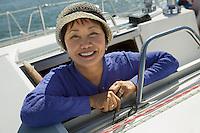 Woman on sailboat smiling (portrait)