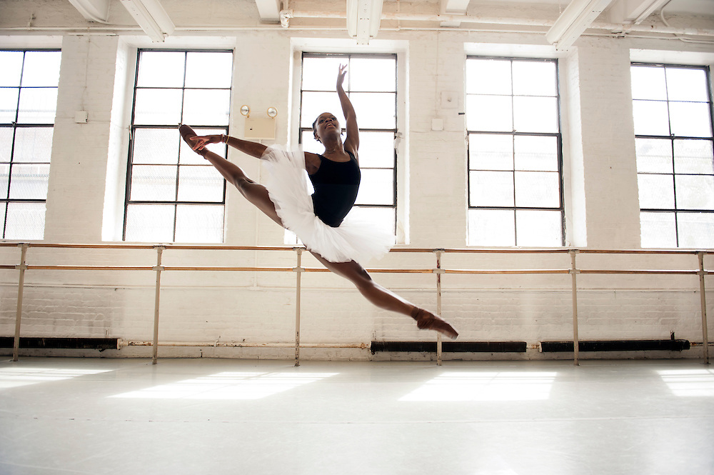 """Dancer Michaela DePrince practices at the Dance Theater of Harlem on 152nd street in Harlem, New York City. ..Michaela DePrince was born in war-torn Sierra Leone on January 6, 1995 where she was named Named Mabinty Bangura. Her adoptive parents were told that her father was shot by rebels when she was three years old, and that her mother starved to death soon after. Frequently malnourished, mistreated, and derided as a """"devil's child"""" because of vitiligo, a skin condition causing depigmentation, she fled to a refugee camp after her orphanage was bombed. In 1999, at age four, she and another girl, Mia, were adopted by Elaine and Charles DePrince from New Jersey, and taken to the United States. (source: Wikipedia)..Photo © Stefan Falke.www.stefanfalke.com"""