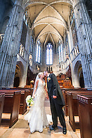 The newlyweds kiss inside the Gothic inspired Heinz Chapel in Oakland.