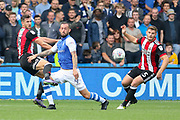 Sheffield Wednesday forward Steven Fletcher (9) battles with Sheffield United defender Jake Wright (13) and Sheffield United defender Jack O'Connell (5) during the EFL Sky Bet Championship match between Sheffield Wednesday and Sheffield Utd at Hillsborough, Sheffield, England on 24 September 2017. Photo by Phil Duncan.