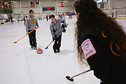 Gabrielle Coleman of Mountain View, right, directs teammates Brian Zaitz, left, and Ryan Winterbourne, both of San Jose, during the San Francisco Bay Area Curling Club's Tuesday night league at Sharks Ice in San Jose on Jan.15, 2013.