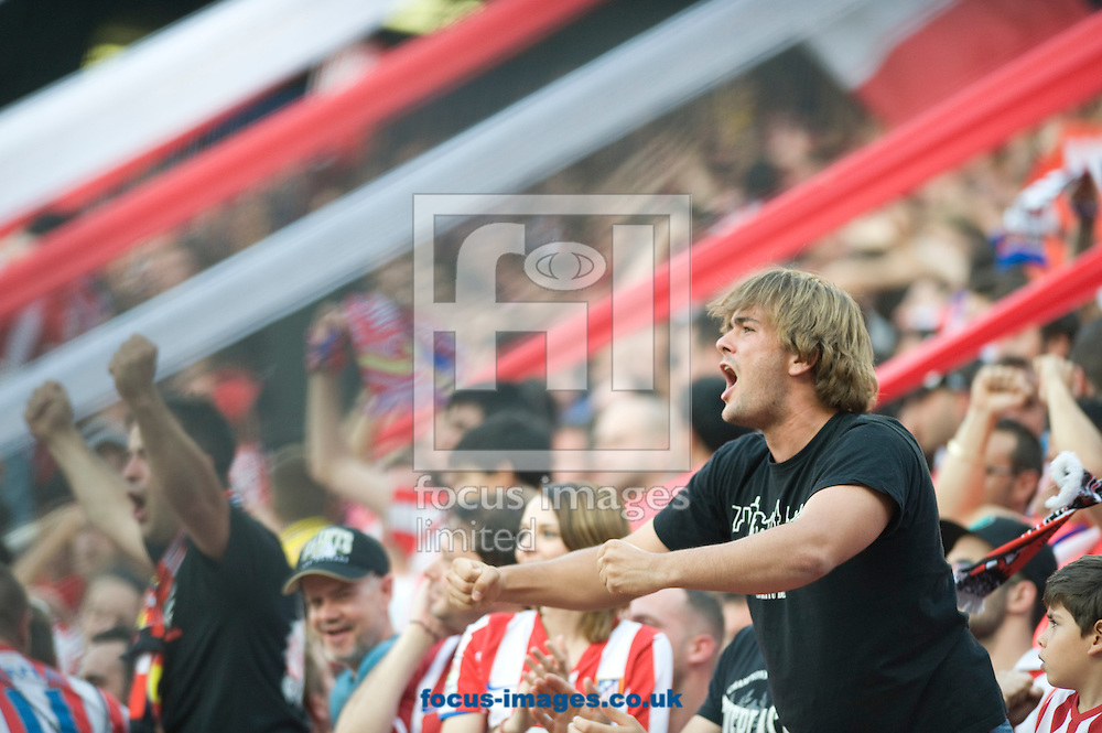 Supporters of Atl&eacute;tico Madrid celebrating the 1-1 during the La Liga match at Vicente Calder&oacute;n Stadium, Madrid<br /> Picture by Marcos Calvo Mesa/Focus Images Ltd +34 654142934<br /> 11/05/2014