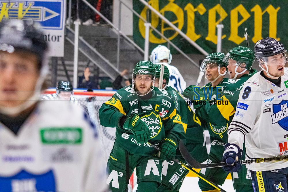 2019-10-09 | Umeå, Sweden:  Björklöven 13 Fredric Andersson scores 6-3 during the game  between Björklöven and Karlskoga at A3 Arena ( Photo by: Michael Lundström | Swe Press Photo )<br /> <br /> Keywords: Umeå, Hockey, HockeyAllsvenskan, A3 Arena, Björklöven, Karlskoga, bk191009