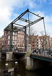 Swing bridge across Brouwersgracht canal in Amsterdam Netherlands