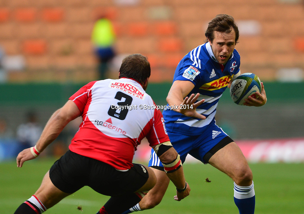Peter Grant of The Stormers runs at Julian Redelinghuys of The Lions during the 2014 Super Rugby Match between The Stormers and The Lions at Newlands Stadium, Cape Town on 19 April 2014 ©Chris Ricco/BackpagePix