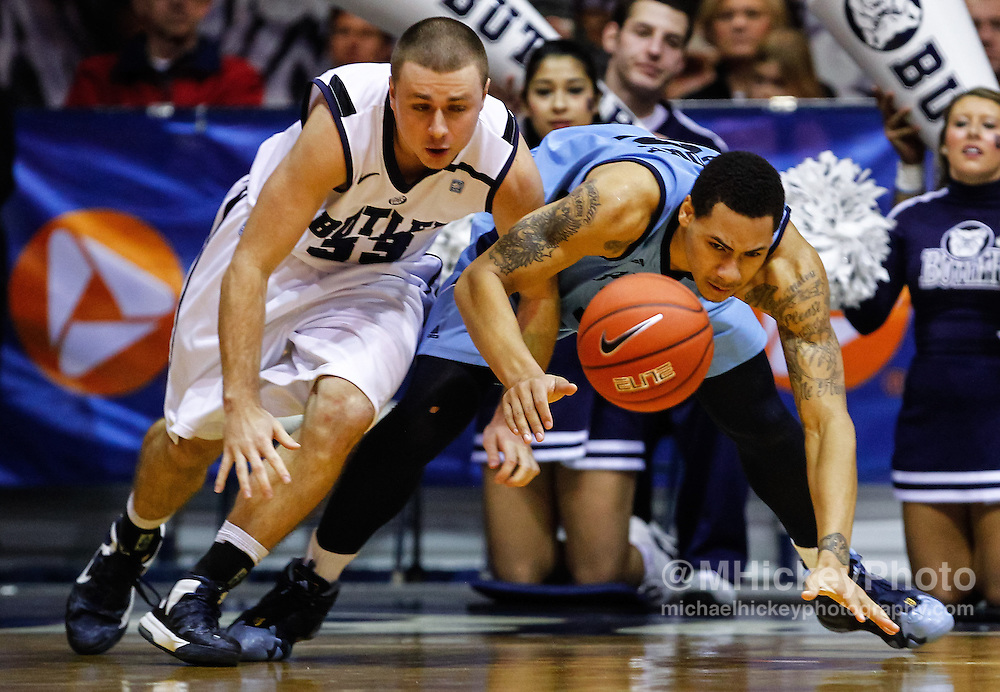 INDIANAPOLIS, IN - FEBRUARY 02: Chase Stigall #33 of the Butler Bulldogs and Andre Malone #12 of the Rhode Island Rams battle for a loose ball at Hinkle Fieldhouse on February 2, 2013 in Indianapolis, Indiana. Butler defeated Rhode Island 75-68. (Photo by Michael Hickey/Getty Images) *** Local Caption *** Chase Stigall; Andre Malone