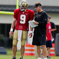 01 August 2009: New Orleans Saints quarterback Drew Brees (9) talks with head coach Sean Payton during New Orleans Saints training camp at the team's practice facility in Metairie, Louisiana.