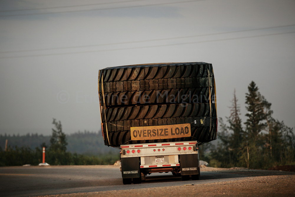 Road delivery of huge Michelin 55/80R63 XDR radial tires for giant mining truck Caterpillar CAT 797B. Size and capacity of giant mining trucks depend on progress by tyre manufacturer. Each tire weight 5,3 tons, has a 4 meter diameter and cost over 40,000$. 02 July 2008. © Etienne de Malglaive.
