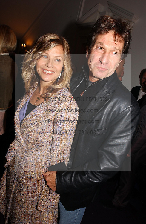 Actor MICHAEL BRANDON his wife actress GLYNIS BARBER at a party hosted by jeweller Theo Fennell and Dominique Heriard Dubreuil of Remy Martin fine Champagne Cognac entitles 'Hot Ice' held at 35 Belgrave Square, London, W1 on 26th October 2004.<br /><br />NON EXCLUSIVE - WORLD RIGHTS