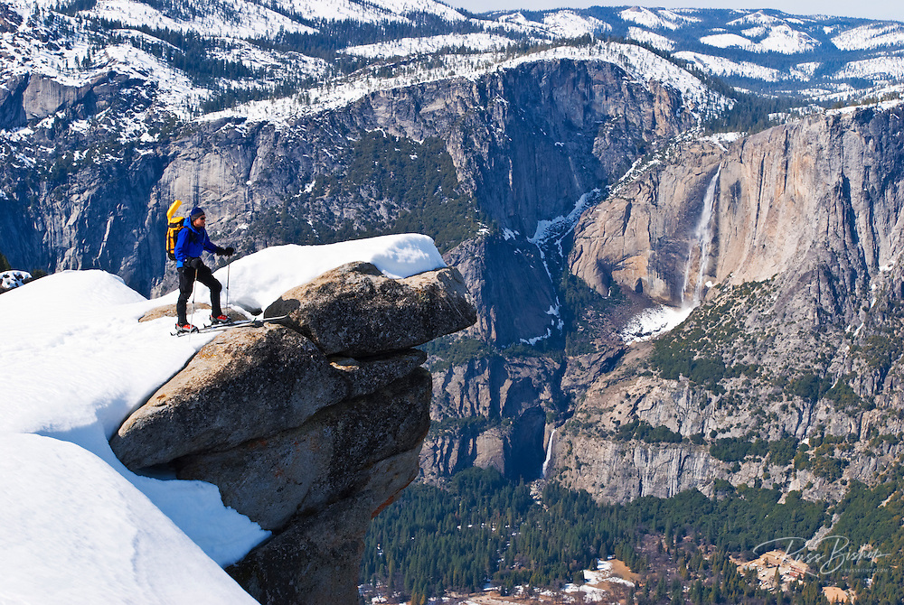 Backcountry skier and Yosemite Falls from Glacier Point, Yosemite National Park, California