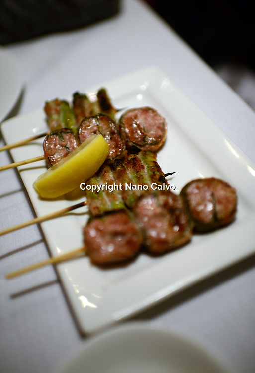 Pork sausage wrapped in shiso leaf, asparagus wrapped in pork skin at Nanbankan yakitori bar and restaurant, Los Angeles, California.