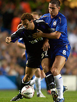 Photo: Daniel Hambury.<br /> Chelsea v Anderlecht. UEFA Champions League.<br /> 13/09/2005.<br /> Chelsea's Frank Lampard and Anderlecht's Anthony Vanden Borre compete for the ball.