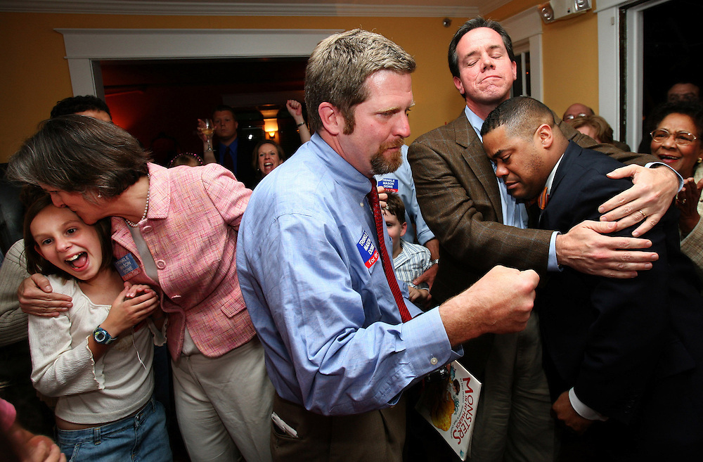 Independent City Council Candidates elect, Gwen Mason (left, kissing girl), Dr. David Trinkle (middle, blue shirt), Mayor Nelson Harris (second from right, hugging Dowe), and Councilman reelect Alfred Dowe, Jr., celebrate the For The City ticket's victory in Tuesday nights Roanoke City Council election.