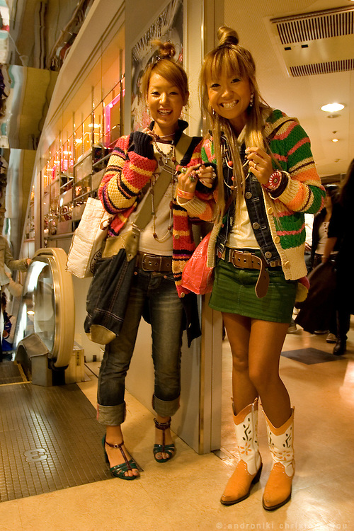 "Inside 109 department store in Shibuya, Masayo (left) and Makiko (right) are on their way to work in the shop COCOLULU. Their style is ""surf fashion"".  Tokyo 4 Apr. 2006"