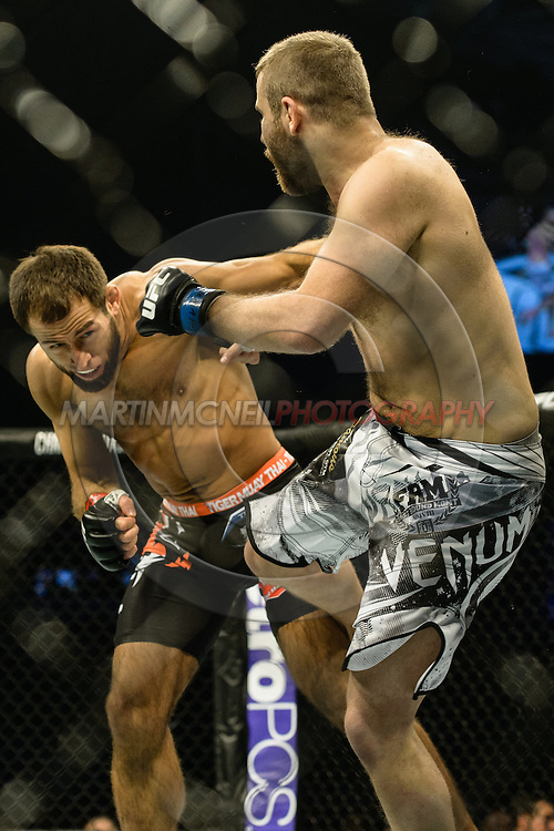 """STOCKHOLM, SWEDEN, JANUARY 24, 2015: Mairbek Taisumov and Anthony Christodoulou during """"UFC on Fox 14: Gustafsson vs. Johnson"""" inside Tele2 Arena in Stockholm, Sweden"""