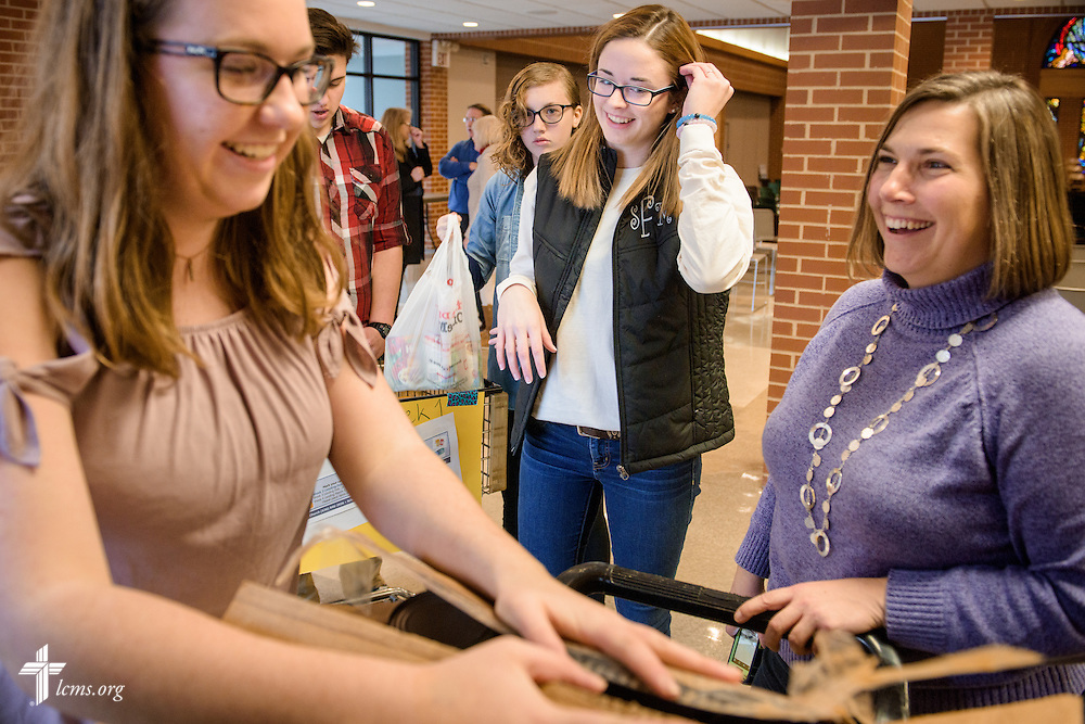 Isabella Schneider (left) counts tuna cans and chats with Jolene Siebarth, director of youth ministries, while Sarah Franklin (center) and fellow friends help pack food pantry items for delivery on Sunday, Feb. 26, 2017, at Immanuel Lutheran Church & School in St. Charles, Mo. LCMS Communications/Erik M. Lunsford
