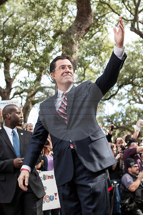 Comedian Stephen Colbert during a rally with former Republican presidential candidate Herman Cain at the College of Charleston on January 20, 2012 in Charleston, South Carolina. Colbert held the event with Cain, titled Rock Me Like a Herman Cain South Cain-olina Primary Rally, as part of his pseudo-run for president of The United States of South Carolina.