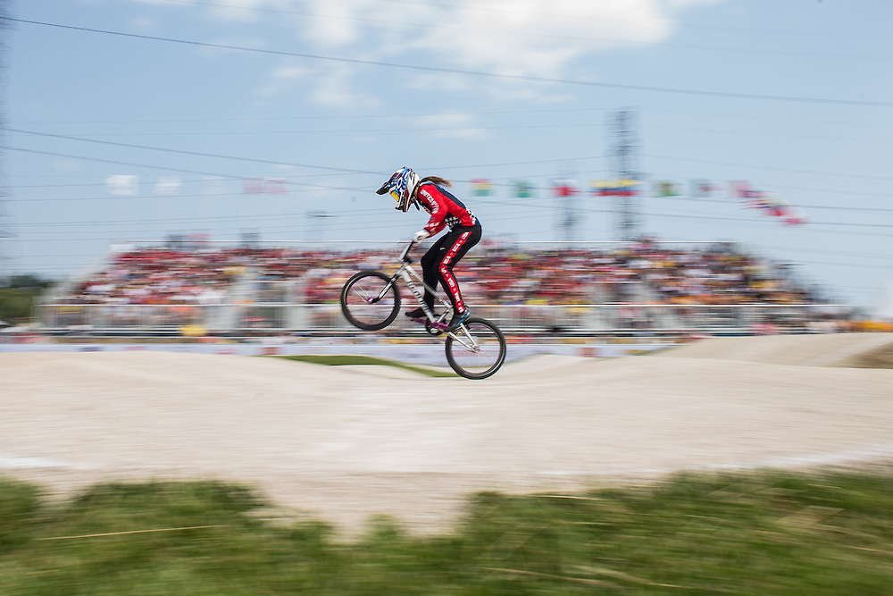 Alise Post of the United States rides in the semi-final at the BMX at the 2015 Pan American Games in Toronto, Canada July 11,  2015.  AFP PHOTO/GEOFF ROBINS