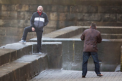 "© Licensed to London News Pictures. 09/11/2015. Bridlington, UK. FRAME 9 OF 9. A man poses for a photograph on the sea defences at the sea side town of Bridlington & gets caught out by a huge wave. The Yorkshire region was hit by severe gales this afternoon with winds up to 60mph. The Met Office warned West Yorkshire to expect gales and locally severe gales over high ground, with some ""very gusty"" winds to the east of high ground as well.<br /> Photo credit: Andrew McCaren/LNP"