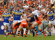 Grant Millington of Castleford Tigers tackles Mikolaj Oledzki (C) of Leeds Rhinos during the Betfred Super League match at the Mend-A-Hose Jungle, Castleford<br /> Picture by Stephen Gaunt/Focus Images Ltd +447904 833202<br /> 08/07/2018