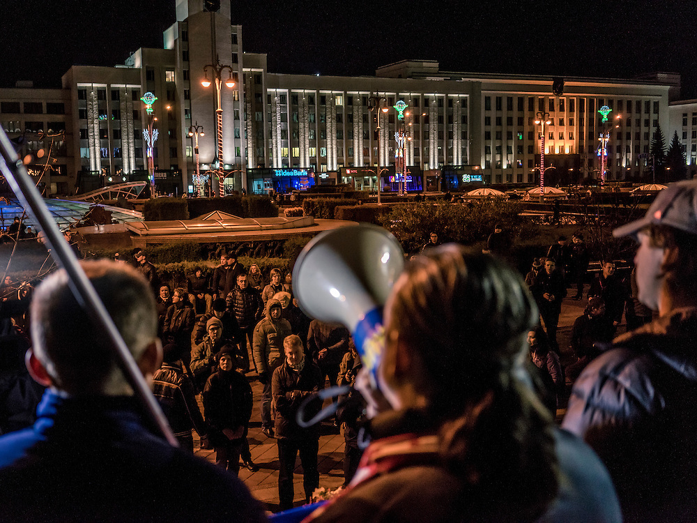 A man speaks through a bullhorn as a small group of people gather to protest presidential election results on Sunday, October 11, 2015 in Minsk, Belarus. President Alexander Lukashenko, a longtime iron-fisted ruler of Belarus, was elected to a fifth term with a reported 83.5% of the vote, which international monitors said did not meet democratic standards.
