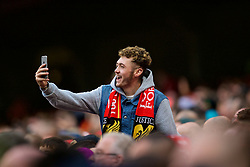 DUBLIN, REPUBLIC OF IRELAND - Saturday, August 5, 2017: A Liverpool supporter takes a photo on his phone during a preseason friendly match between Athletic Club Bilbao and Liverpool at the Aviva Stadium. (Pic by David Rawcliffe/Propaganda)