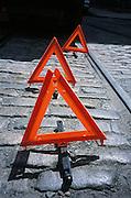 triangular traffic caution signs on street