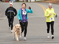 Pumping her fist Jadi Seiz along with Susan Laramie come into the homestretch of the Frozen 5K Saturday morning to benefit the WLNH Children's Auction.    (Karen Bobotas/for the Laconia Daily Sun)