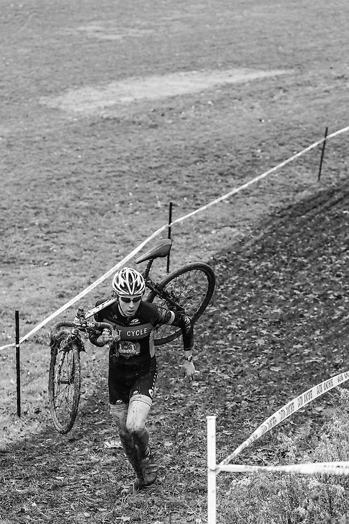 Ian Broadhead carries his bike up a challenging hill at the 2012 Broadview Heights, Ohio cyclocross race.