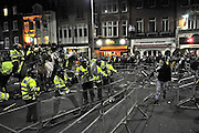 10/01/2009 Police in riot gear confronted around 20,000 protesters waving banners and Palestinian flags outside the Israeli embassy in central London.