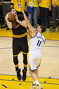 Golden State Warriors guard Klay Thompson (11) defends Cleveland Cavaliers forward Kevin Love (0) during Game 5 of the NBA Finals at Oracle Arena in Oakland, Calif., on June 12, 2017. (Stan Olszewski/Special to S.F. Examiner)